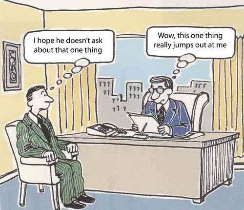 Cartoon - recruiter examining a CV, candidate hoping he won't notice something