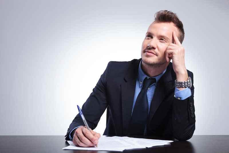 How long should a CV be? Man writing CV