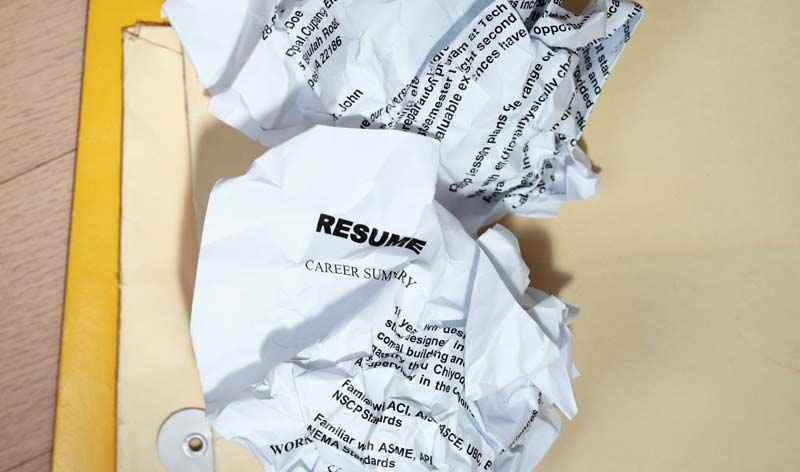 Resume or CV in the waste paper bin