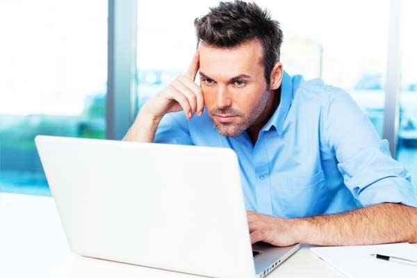 Man carrying out job interview preparation researching company