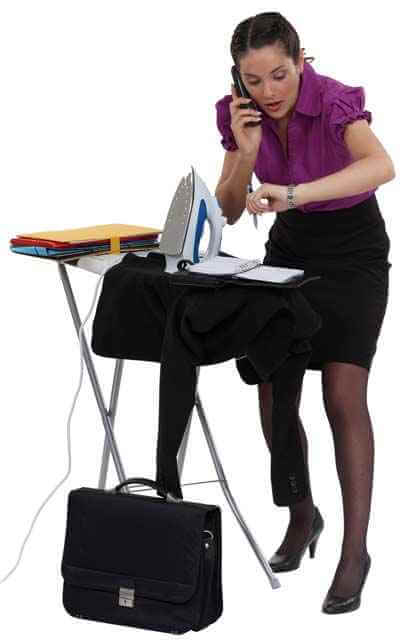 Woman ironing clothes for job interview