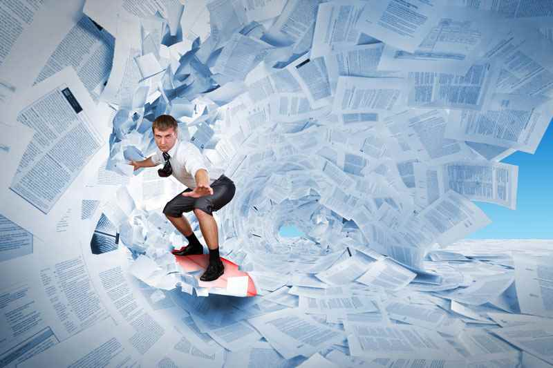 How long should a CV be? Man riding waves of paper